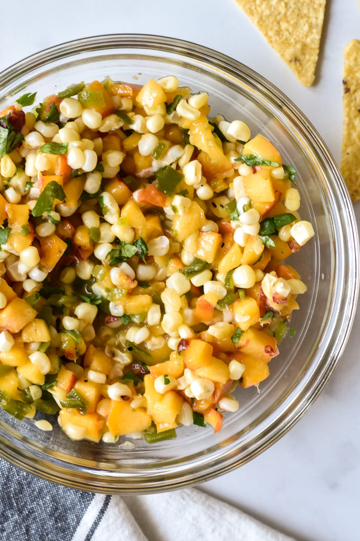 peach, corn and hatch green chile salsa in a large bowl