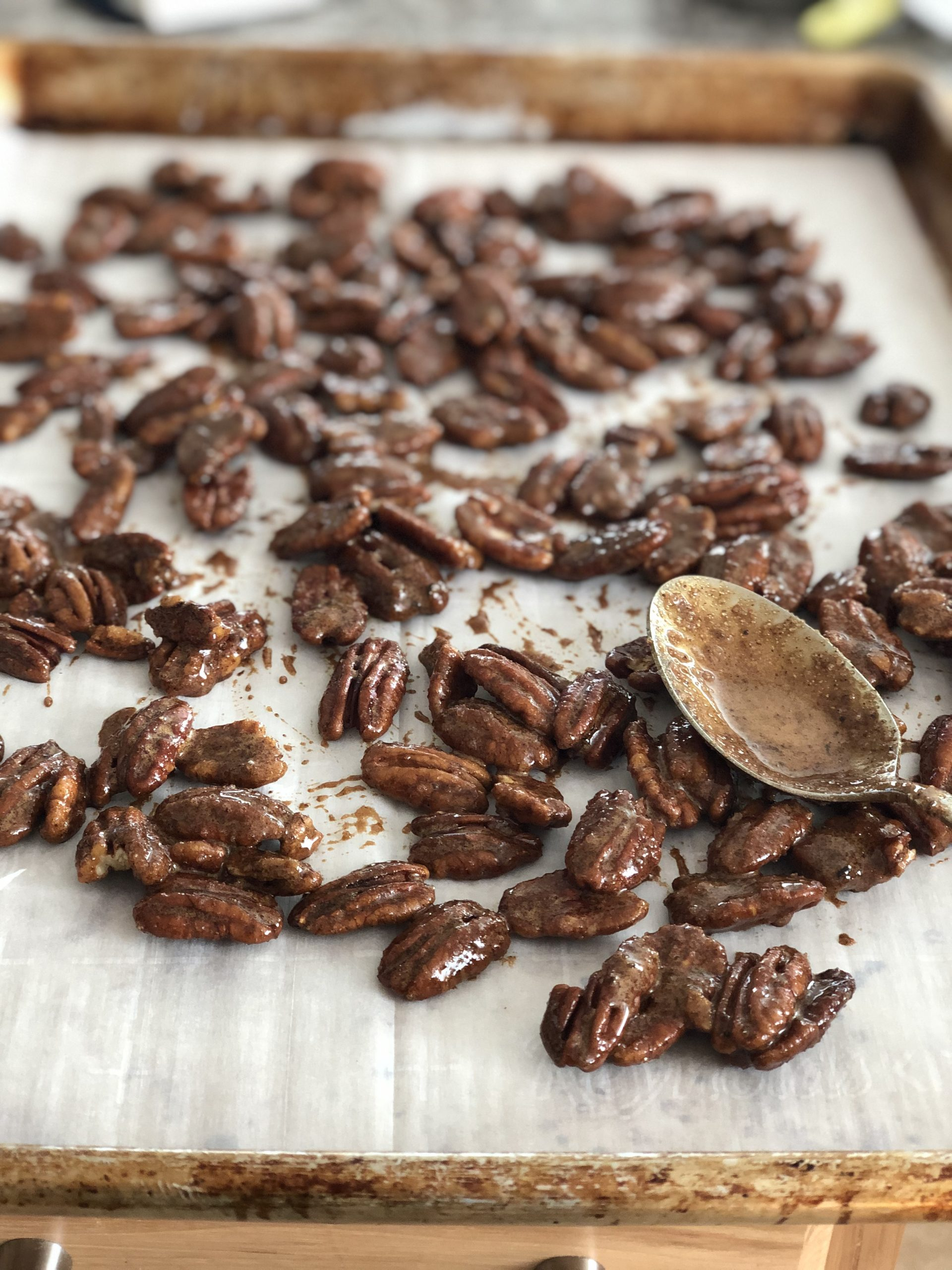 dirty chai spiced pecans on a sheet pan
