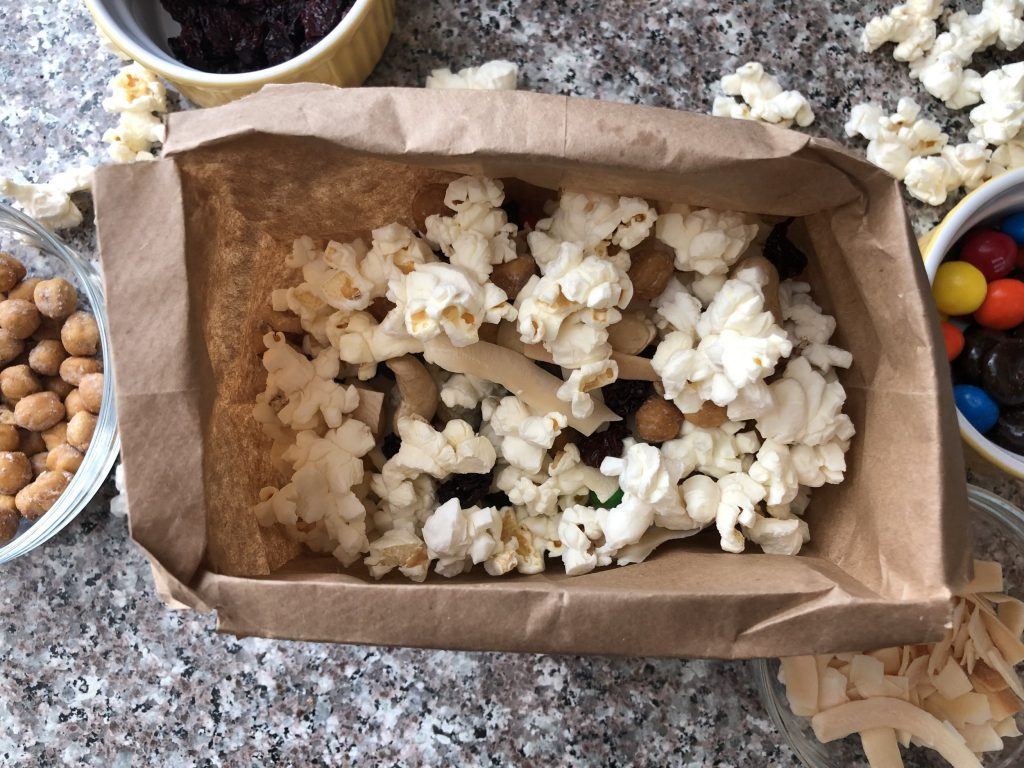 popcorn in a brown paper bag