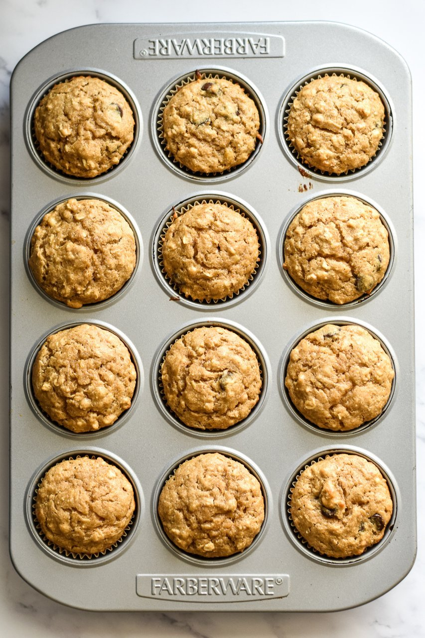 muffin tin full of peanut butter chocolate chip muffins