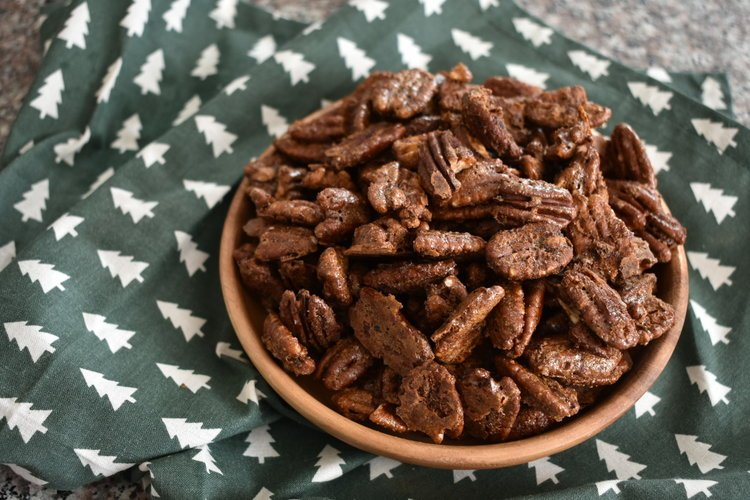 spiced pecans on a plate