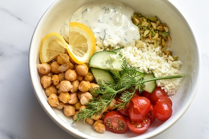 chickpea bowl with toppings and tzatziki sauce