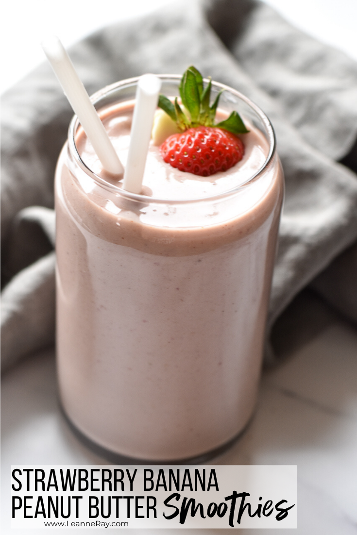 smoothie in a fancy glass with strawberry