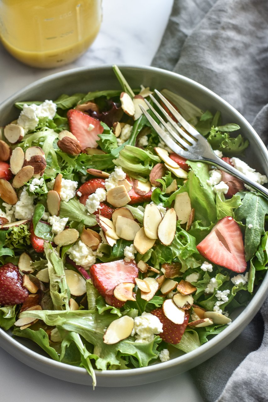 strawberry goat cheese salad in a bowl