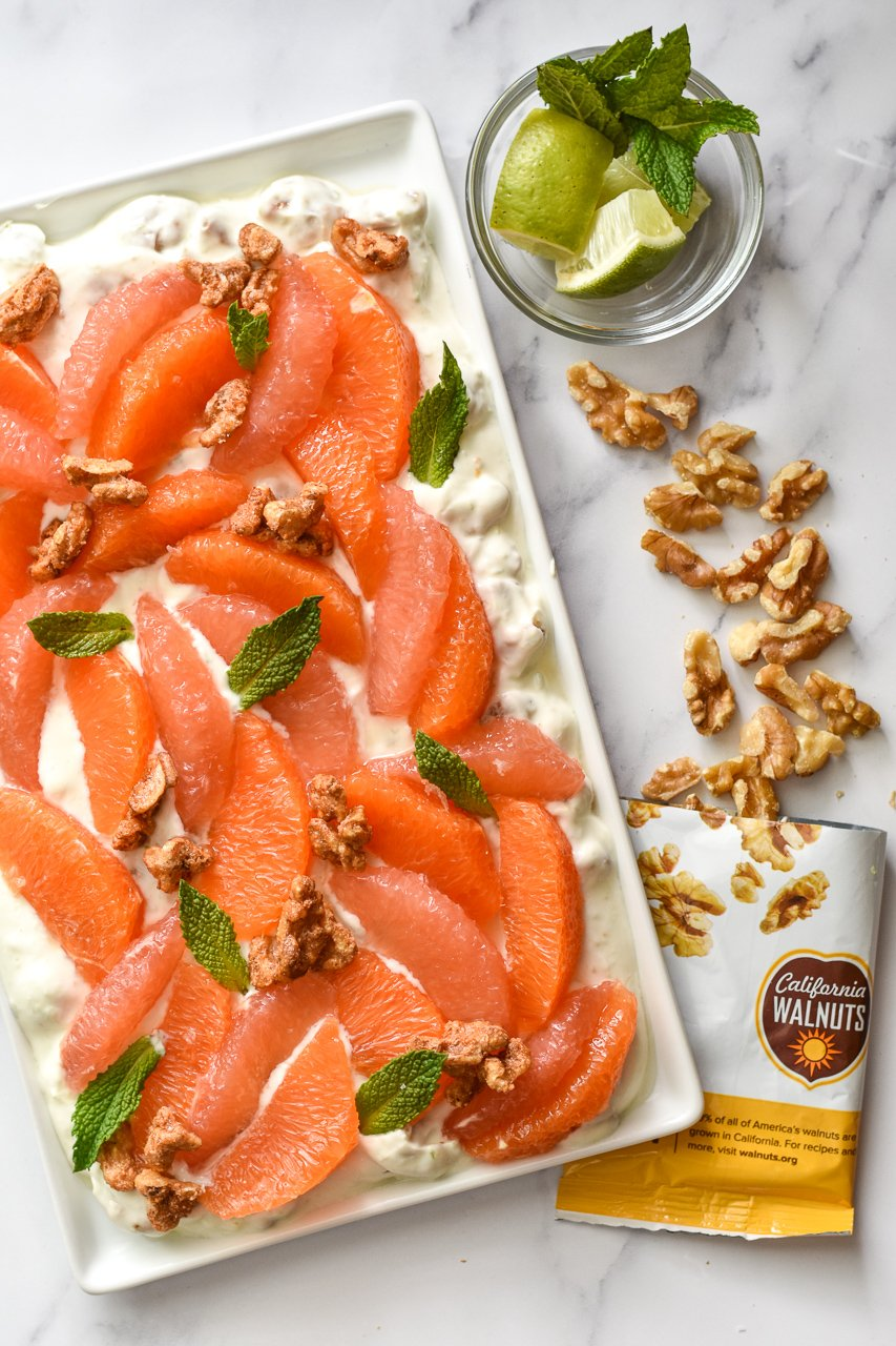 citrus fruit on a platter with spicy walnuts and mint