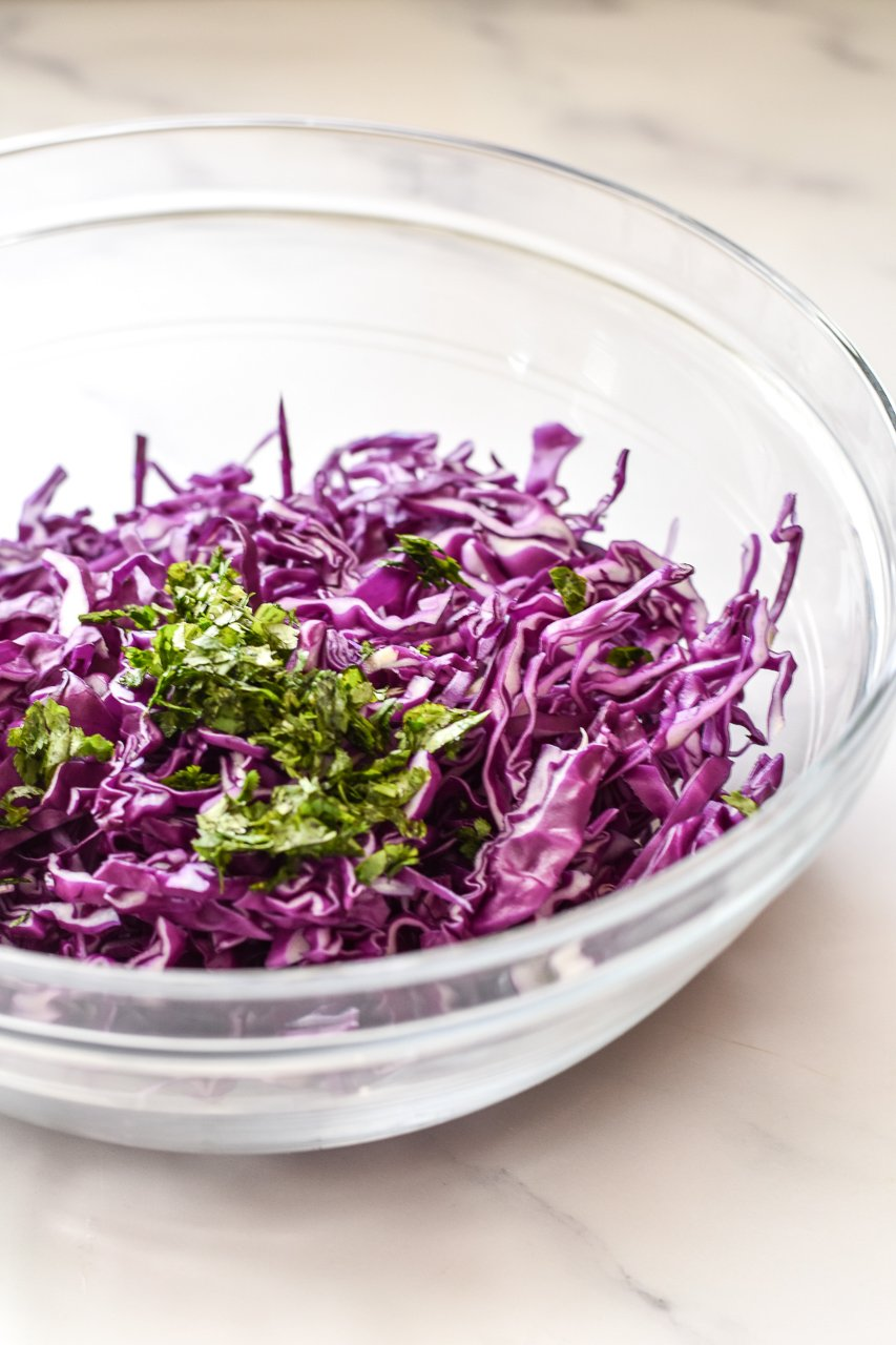 shredded purple cabbage and cilantro in a bowl