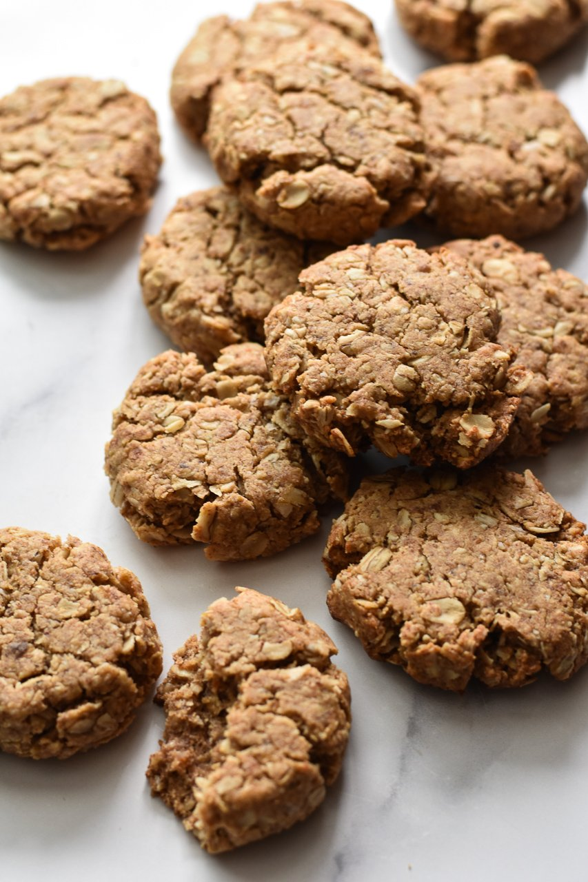 vegan oatmeal cookies scattered on counter