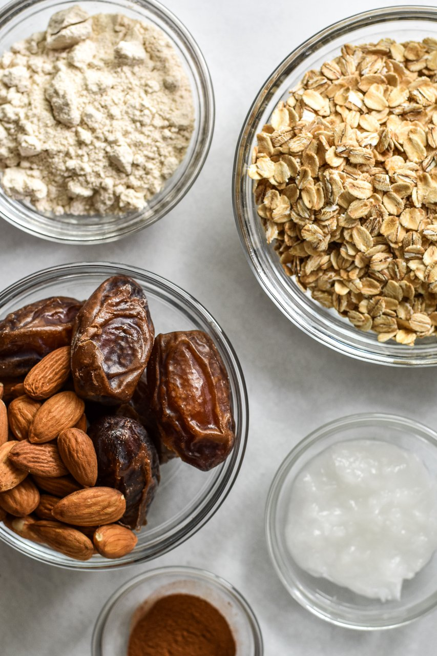 vegan oatmeal cookie ingredients in bowls