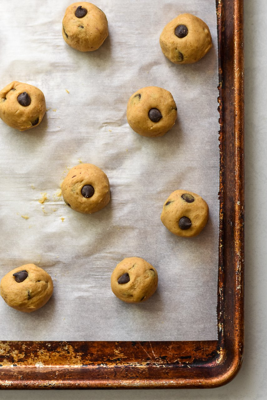 cookie dough bites on a sheet pan lined with parchment paper