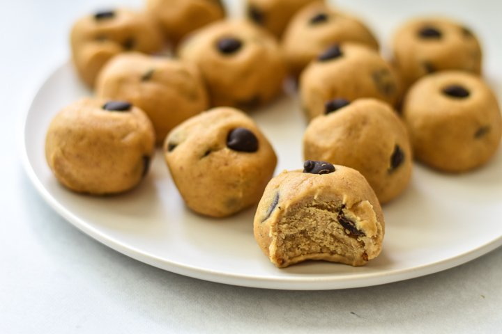 vegan chickpea cookie dough bites with bite taken out of one