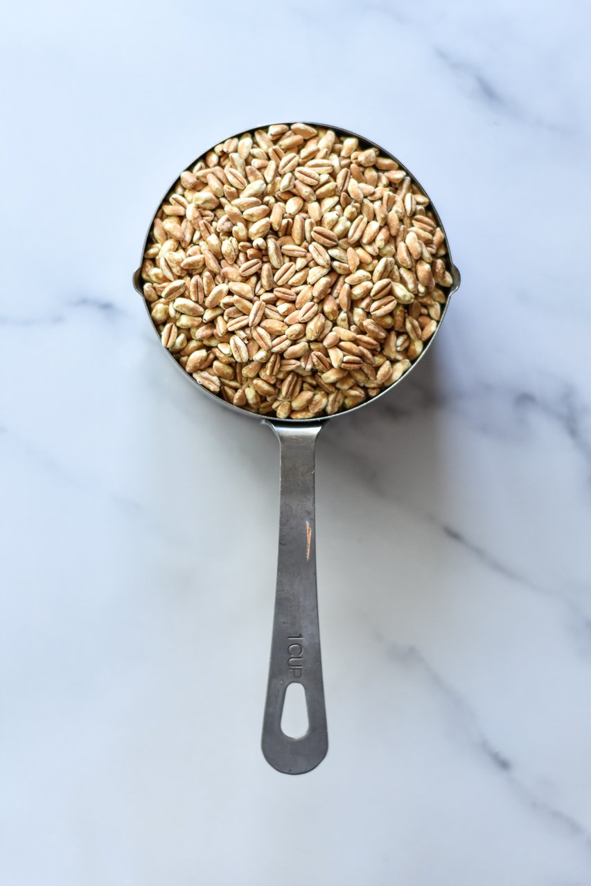 raw farro in a measuring cup