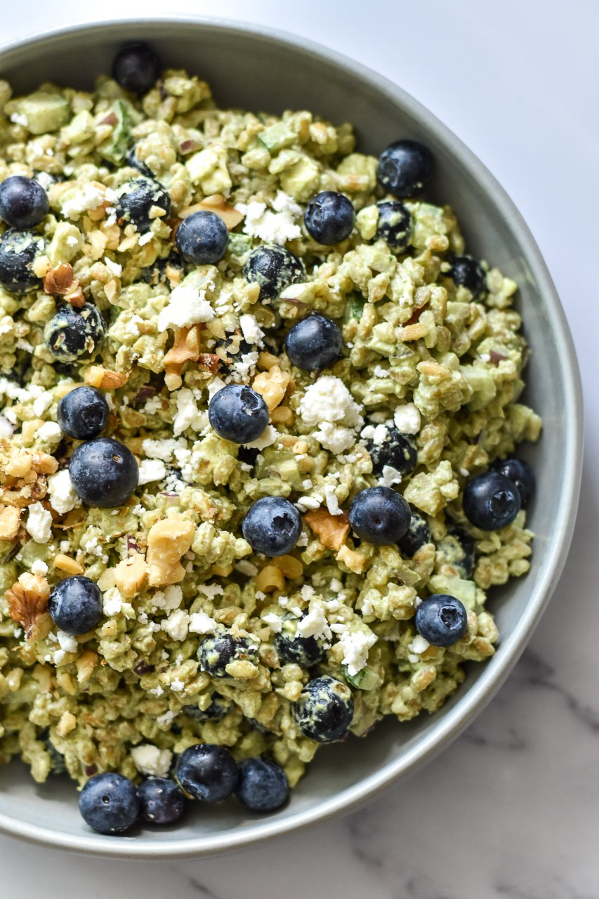 summer farro salad with blueberries feta and walnuts in a serving dish