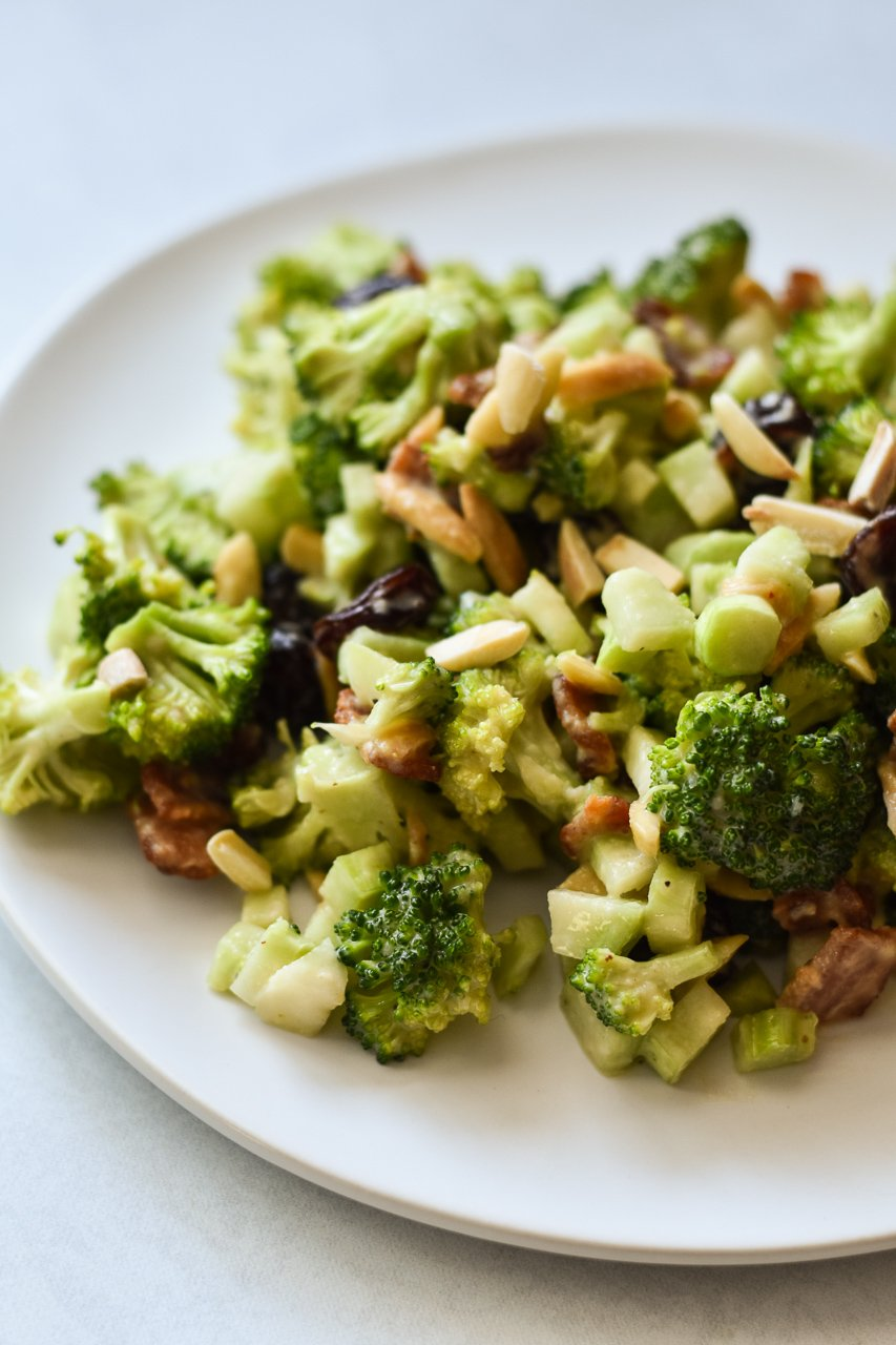 close up of broccoli salad on plate