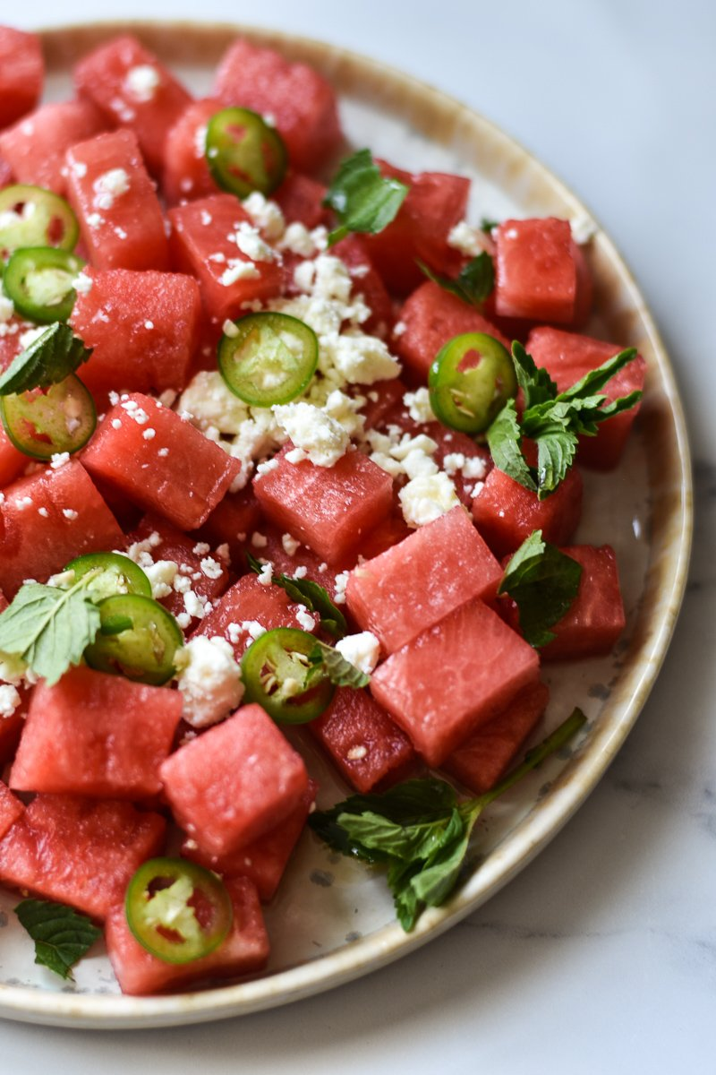 close-up of watermelon salad with feta mint and serrano peppers