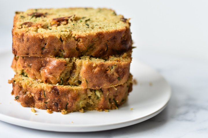 zucchini bread slices stacked on a plate