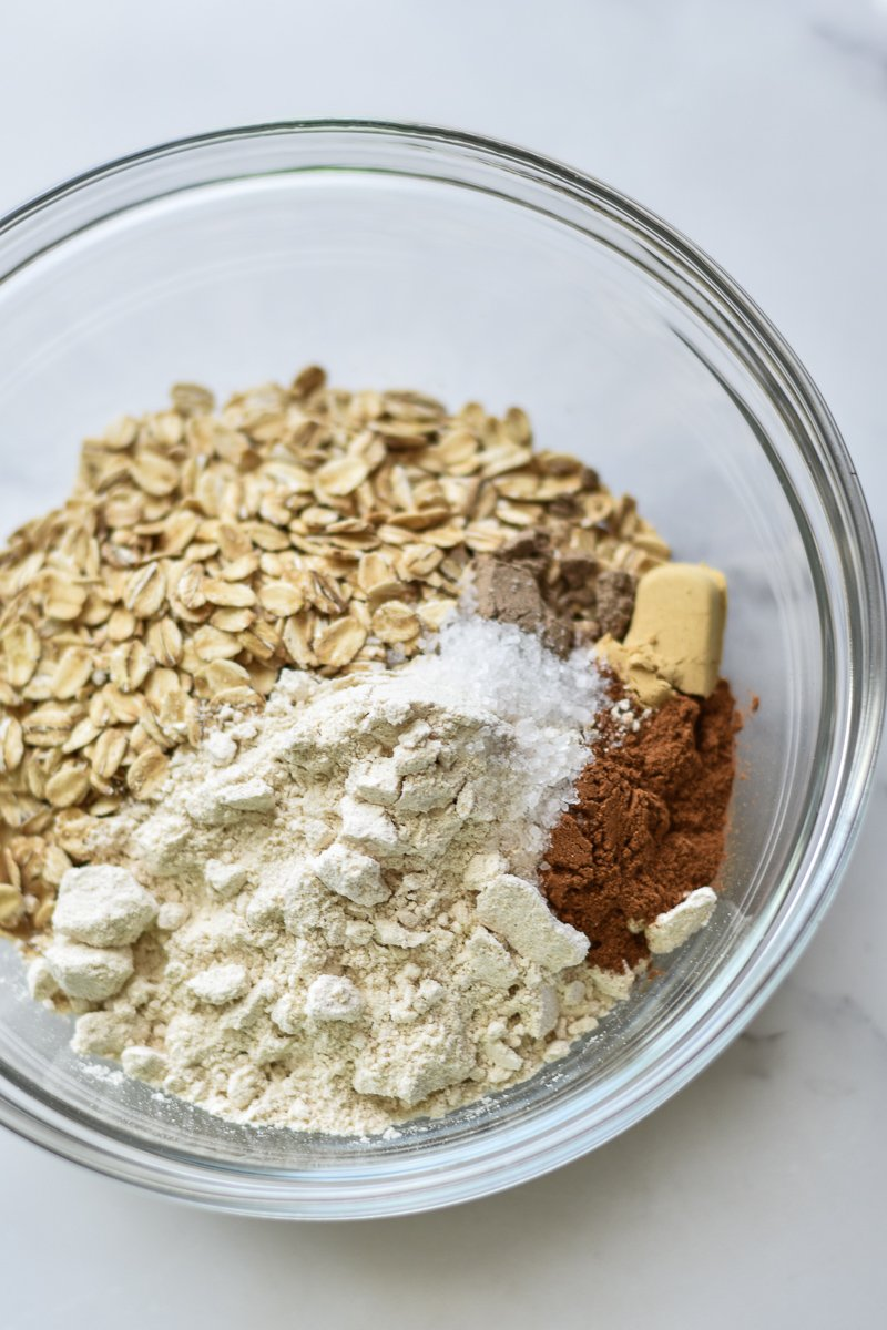 oats, flour and spices in a mixing bowl