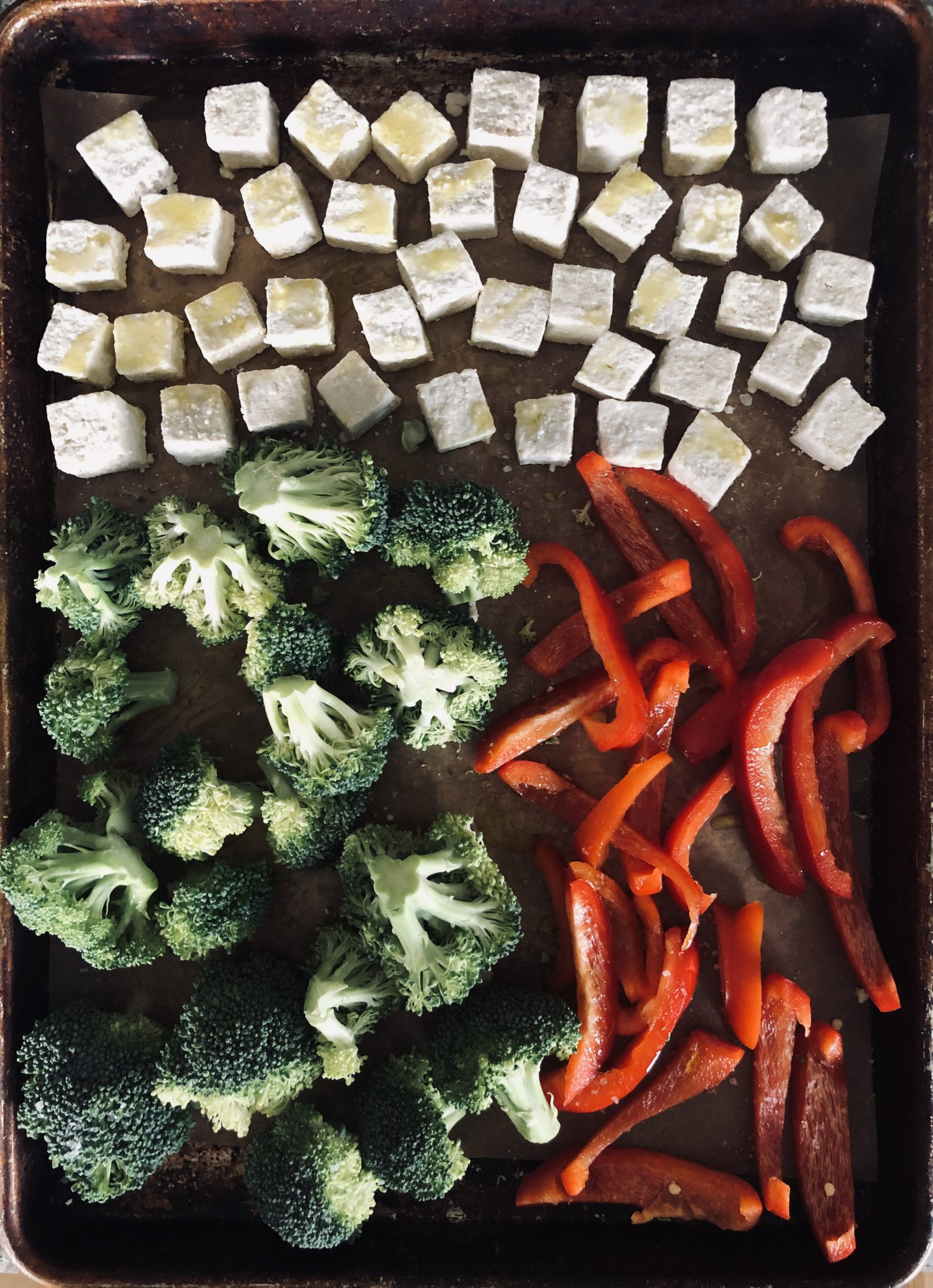 tofu, broccoli, and red pepper slices on a sheet pan