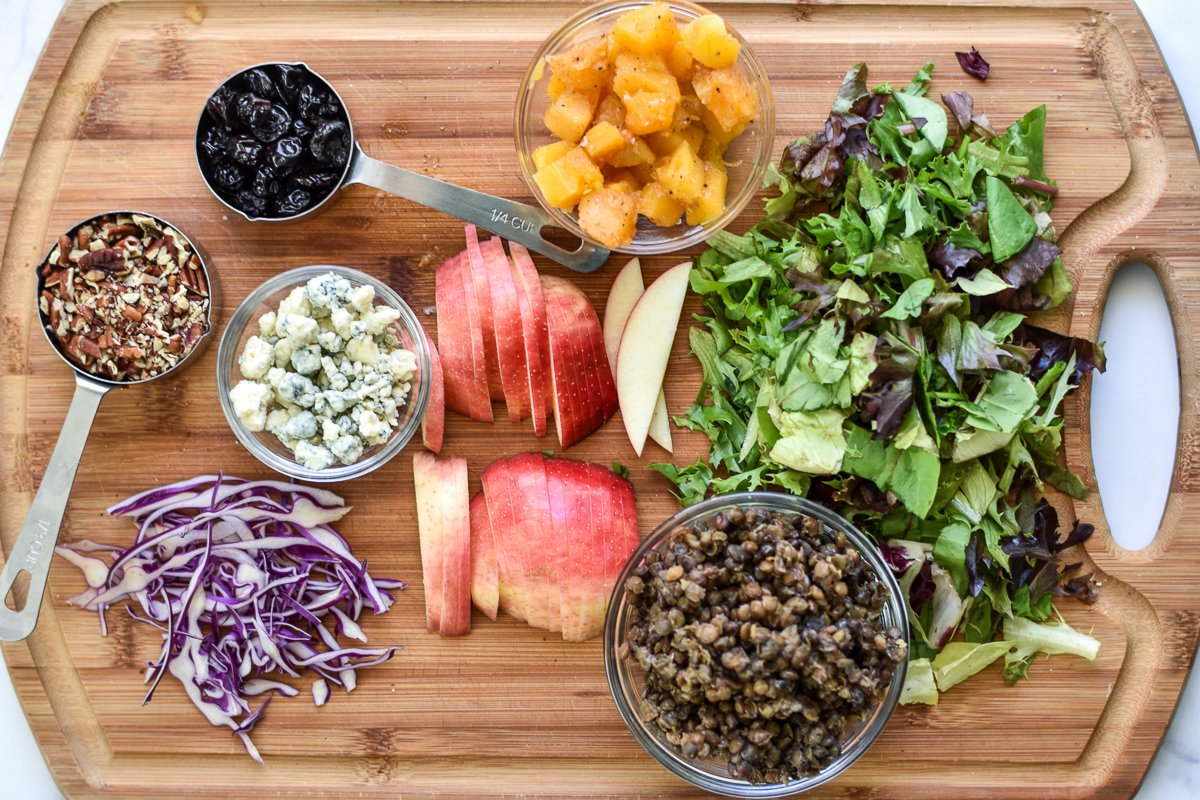 ingredients for a rice bowl laid out on a wood cutting board