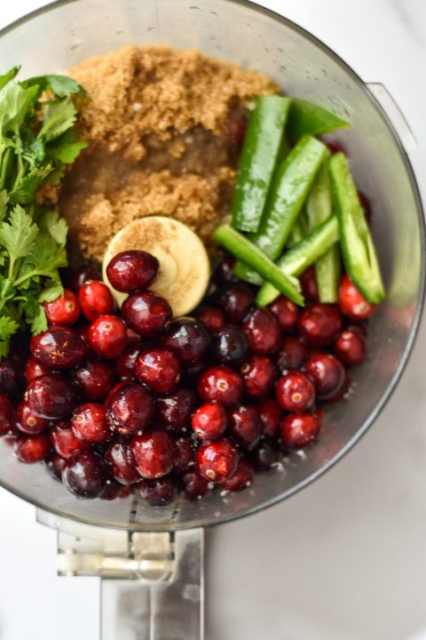 food processor with ingredients for jalapeno cranberry dip