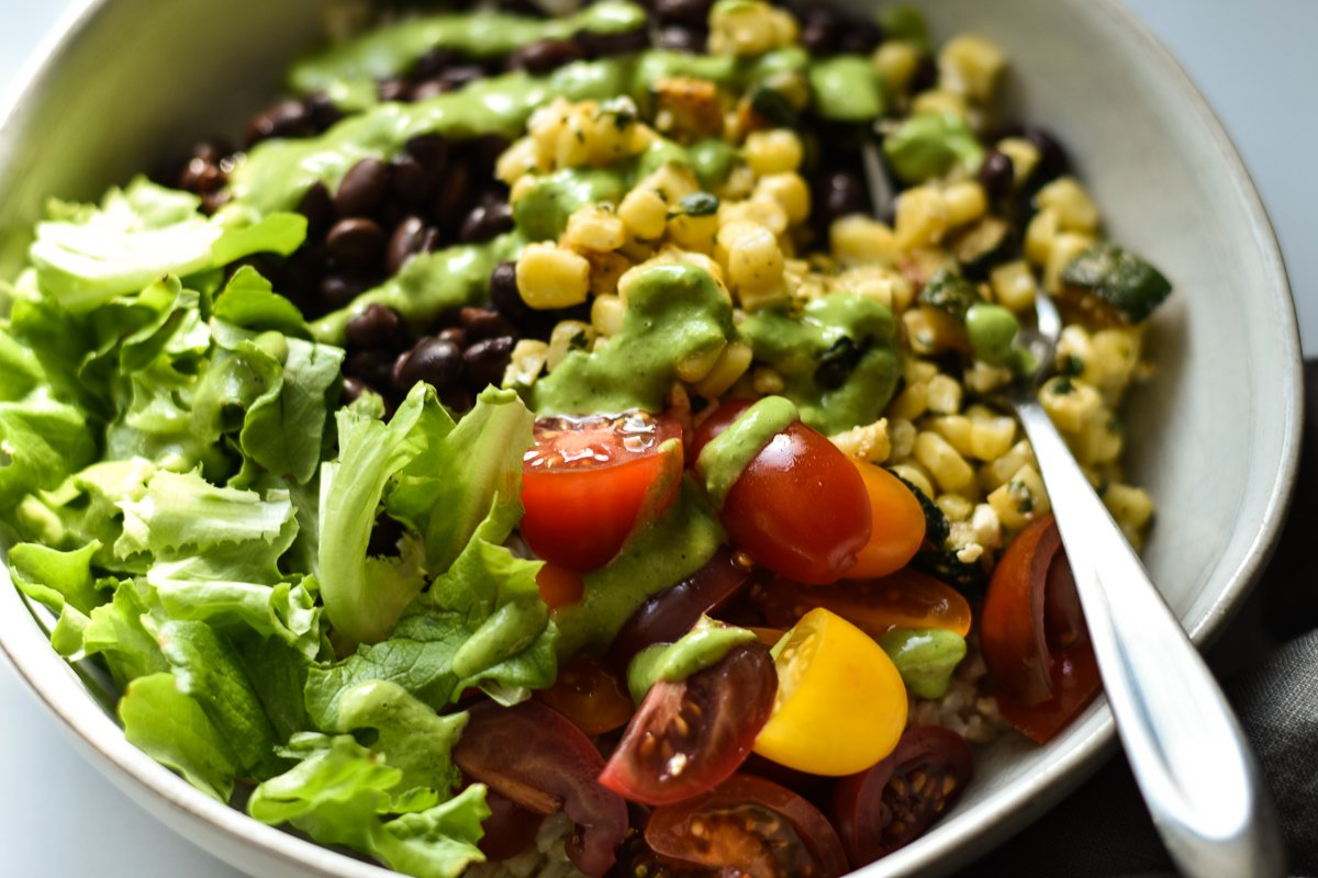 vegetarian burrito bowl with a drizzle of green goddess dressing