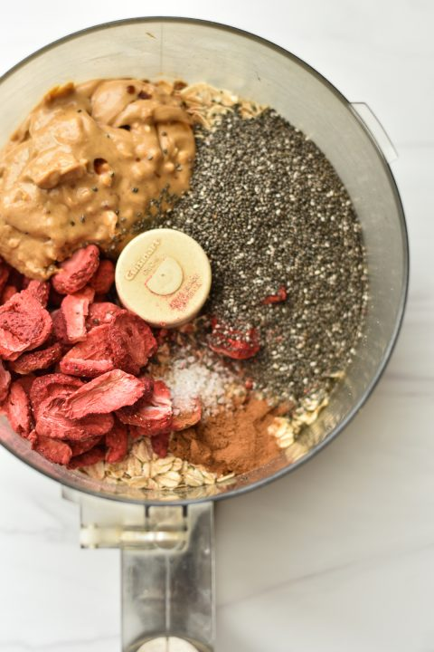 food processor filled with oatmeal bite ingredients