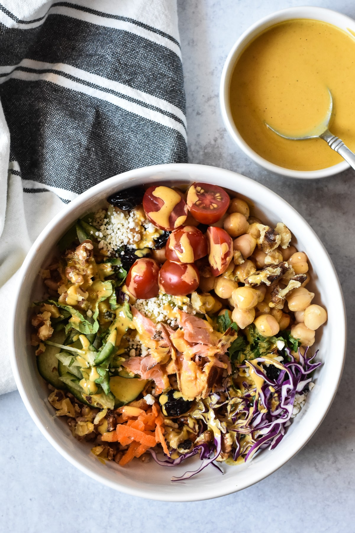 nourish bowl with a side of tahini sauce