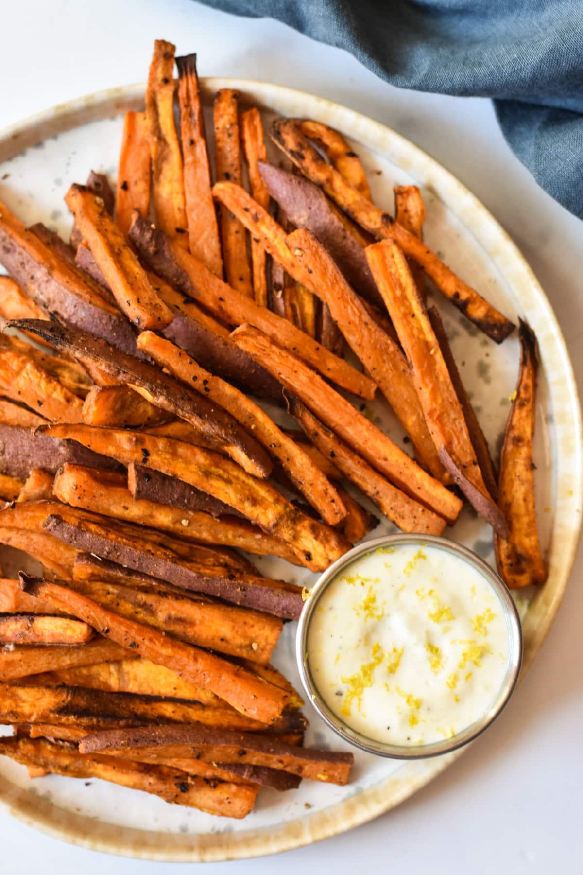 plate of sweet potato fries with aioli sauce