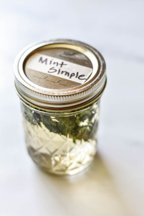 jar of mint simple syrup with label