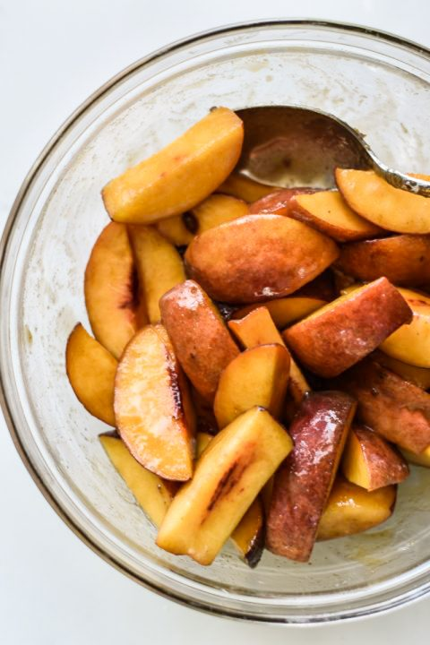 bowl of sliced peaches tossed in sugar