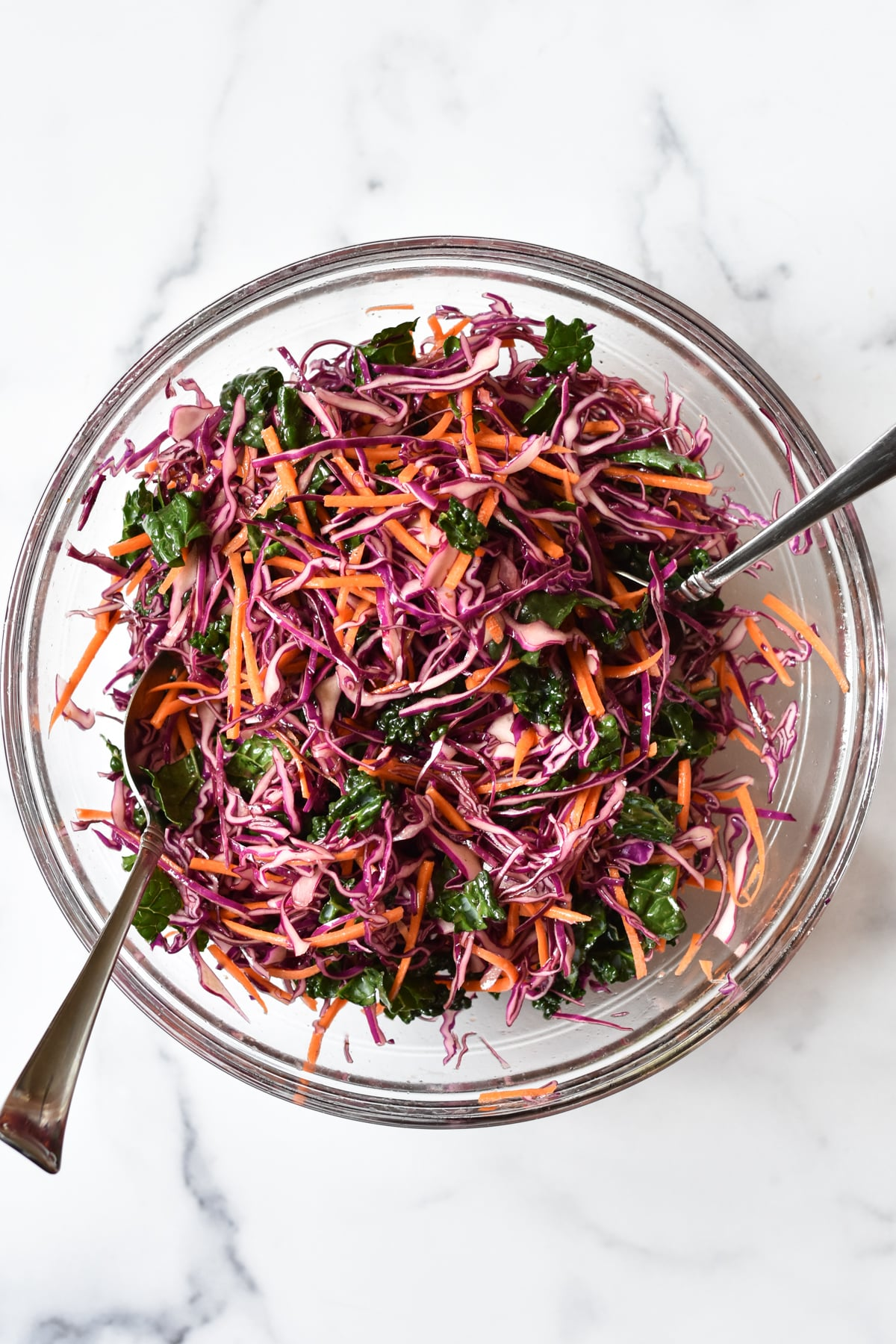 purple cabbage slaw in a large bowl with serving ware