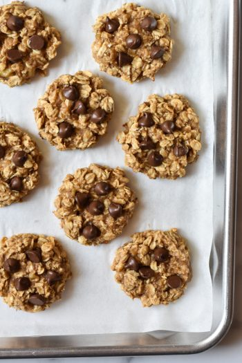 4 ingredient oatmeal cookies with chocolate chips on a cookie sheet